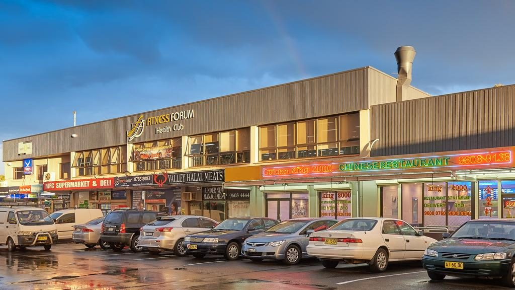 This busy shopping strip has changed hands after more than half a century.