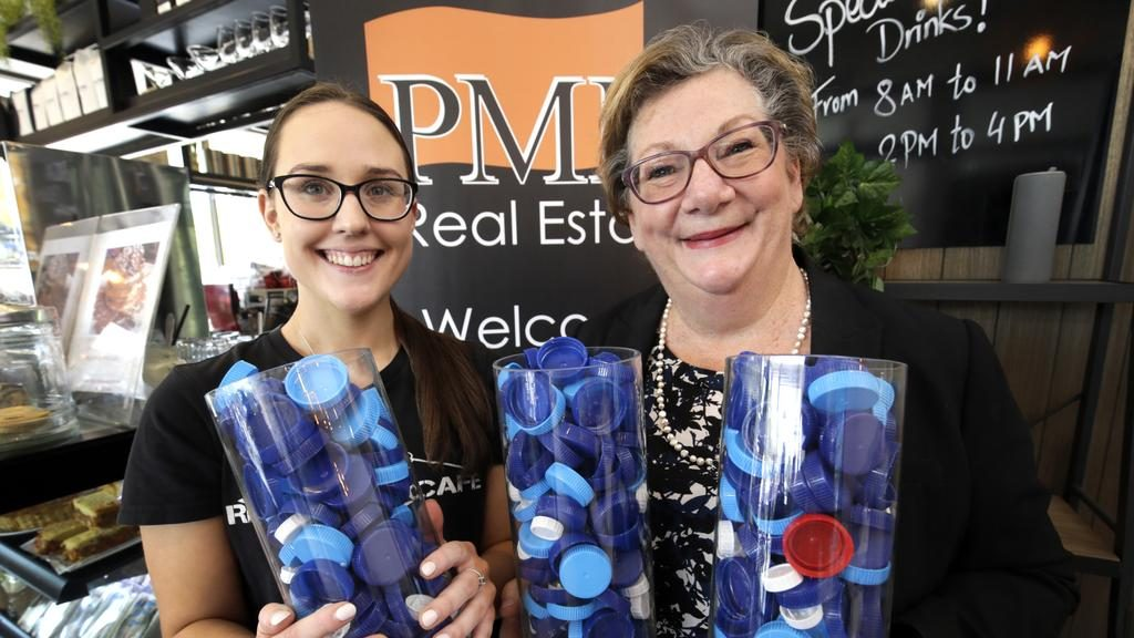 PMM Real Estate and Rhyme Street Cafe have joined forces to collect milk container tops to be used in prosthesis joints. PMM Senior Property consultant, Michelle Blom (right) and Rhyme Street Cafe team member, Willow Wright with some of the plastic bottle tops they have collected. Picture: ROGER LOVELL