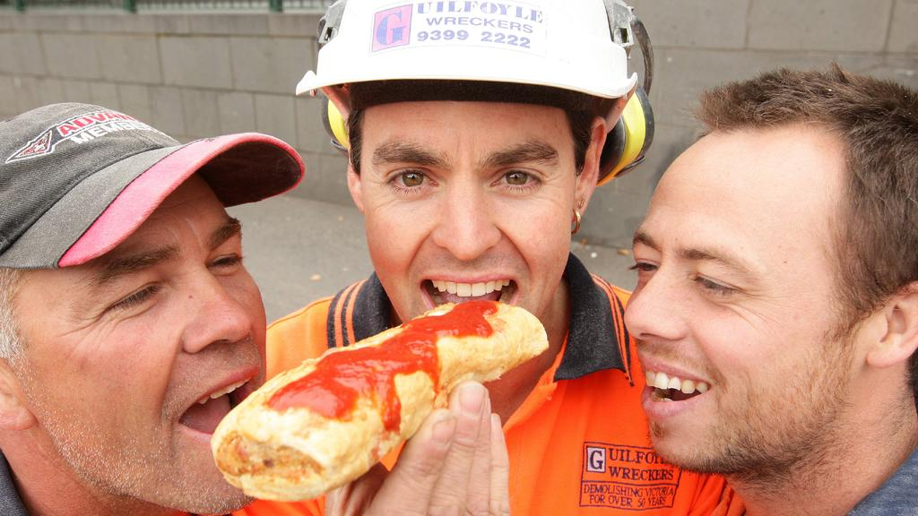 (L-R) Danny Smith (46), Simon May (36) and Shane Haitana (33) try the new Four N Twenty sausage roll at South Bank