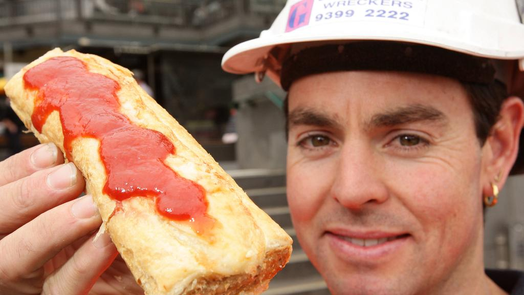 Simon May (36) tries the new Four N Twenty sausage roll at South Bank.