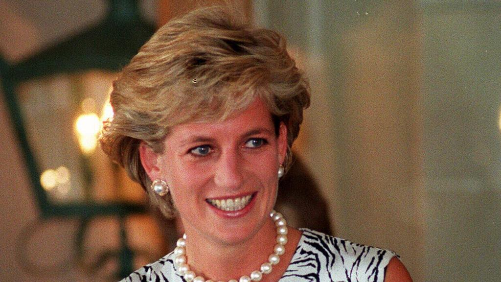 Diana, Princess of Wales, leaving Ritz-Carlton Hotel at end of her visit to Sydney.  australia royalty