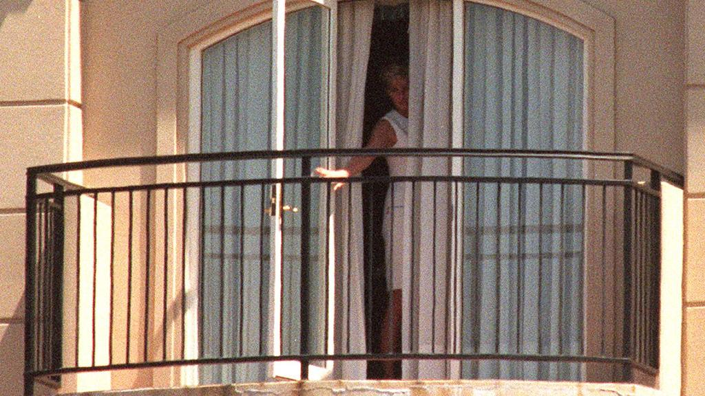 Diana Princess of Wales looking out of balcony door at Ritz Carlton, Double Bay, Sydney hotel.