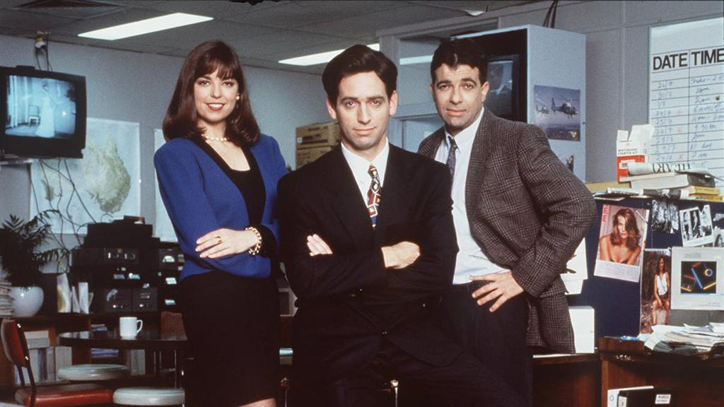 ABC comedy series Frontline. tv actor actress cast newsroom (L-R) Jane Kennedy, Rob Sitch, Tiriel Mora. comedian comedienne headshot