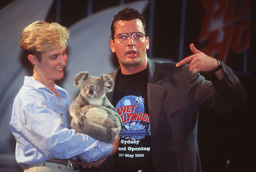 American actor Charlie Sheen patting a koala at the official opening to the public of Planet Hollywood in Sydney in 1996. Picture: Patrick Riviere/Getty Images